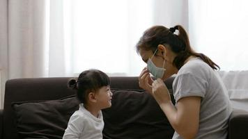 Mother Putting Mask on Her Daughter to Prevent Infection video