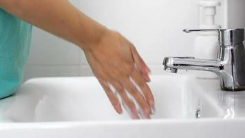 Woman Washing Hands with Foam Soap and Water in The Bathroom video