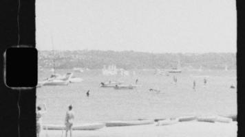 Super 8 Black and White - People on Paddle Boards