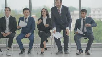 Group of People Stand and Go Away from Chairs After Finishing Job Interview