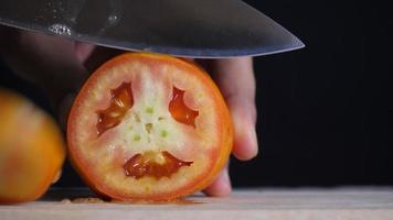 Chef Slices Red Tomatoes for Cooking