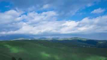 Green Mountain Landscape With Hills And Clouds
