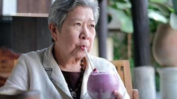 Elderly Senior Drinking a Blueberry Milkshake video