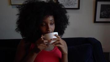 Black Woman at Home Drinking Tea or Coffee video