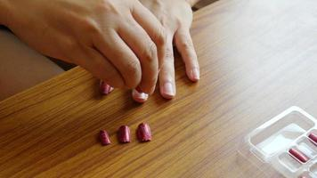 Lady putting artificial nail