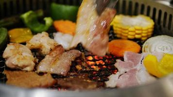 Closeup of coal grill barbecue with fresh delicious meat and vegetables