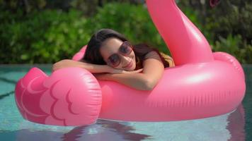 Woman relaxes with a float video