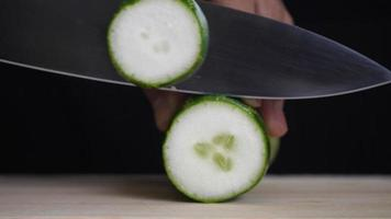 Chef Slices Cucumber for Cooking