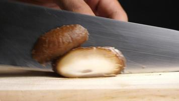 Chef Slices Shiitake Mushroom for Cooking