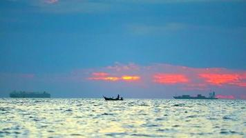 Sunset on The Sea and Focus on A Fishing Boat video