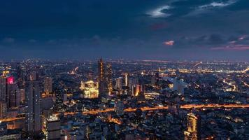 Time lapse view of Bangkok in the evening and the business center lighting up video