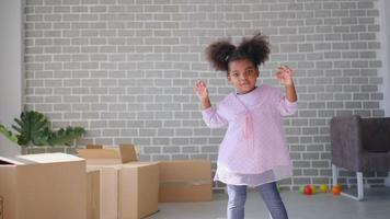 Little African-American Girl Dancing in The Living Room