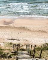 View to old wooden stairs to the seaside photo