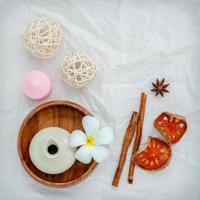 Spa products on a crinkled white background photo