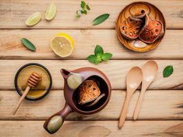 Herbal tea pot with fresh herbs photo