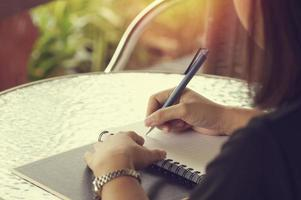 Female student writing in notebook photo