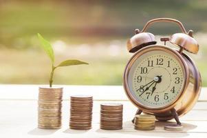 Coins with an alarm clock photo