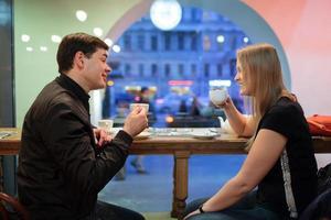 Couple enjoying coffee at night photo