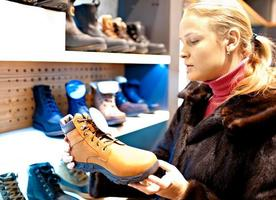 Woman in a shoe store photo