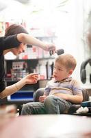 Boy getting a haircut photo