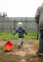 Happy grandson runs with grandfather