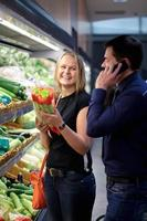 Couple shopping for produce