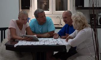 Family enjoying time together at a kitchen table photo