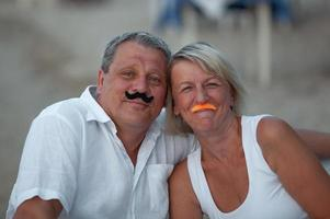 Couple with pretend mustaches