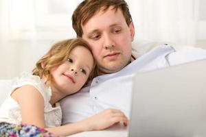 Daughter and father using a laptop