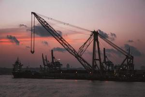 Heavy cranes on the water photo