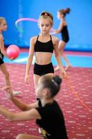 Girls practicing gymnastics