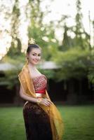 Beautiful woman wearing a typical Thai dress photo