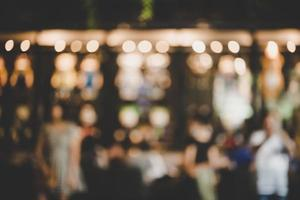 Blur image of night market festival with bokeh photo
