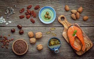 Omega 3 foods on a wood background photo