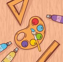 art palette with ink and brush on a wooden background