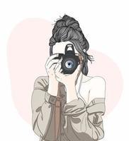 mujer de moda de dibujos animados con cámara vector