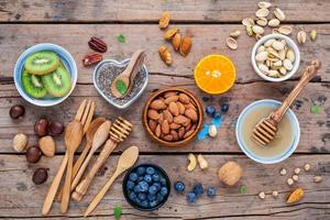 Healthy ingredients on wood background photo