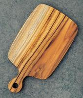 Cutting board on dark stone background photo
