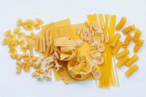 Assorted pasta on white photo