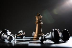 King and knight of chess setup on dark background