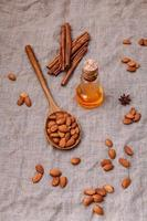 Almonds, oil, and cinnamon photo