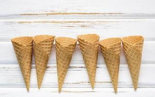 Ice cream cones on a white wooden background
