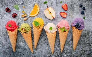 Fruit and ice cream on concrete