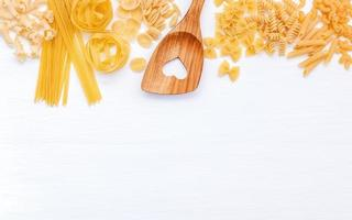 Pasta and a wooden spoon with copy space