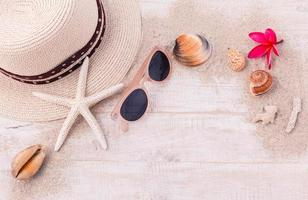 Summer accessories on wooden background photo
