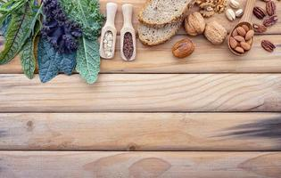Fresh ingredient border on wood photo