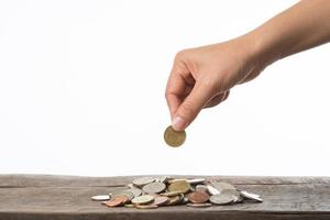 Woman's hand holding coins for collecting photo
