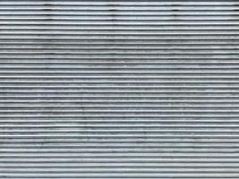 A grey color metal garage door photo