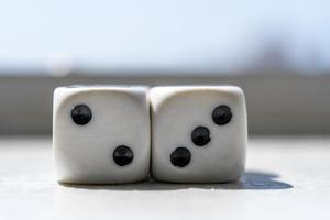 Two dices with a blurry background photo