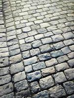 Old and dirty cobblestone road photo